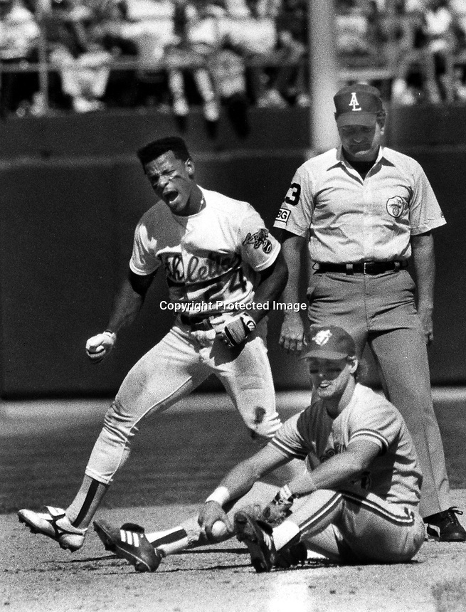 Rickey Henderson after stealing 3rd base against the Blue Jay's...photo Ron Riesterer