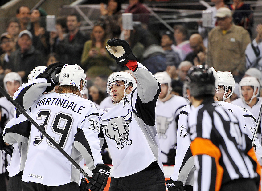 San Antonio Rampage players celebrate a goal in the second period of an AHL hockey game against the Rochester Americans, Saturday, Jan. 18, 2014, in San Antonio (Darren Abate/AHL)
