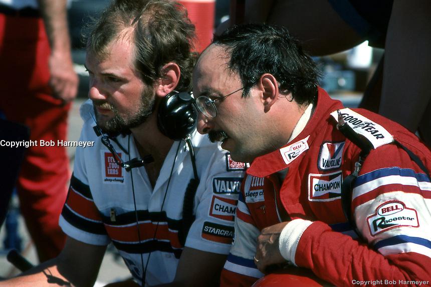 AVONDALE, AZ - APRIL 15: Bobby Rahal (right) and engineer Adrian Newey in the pit lane before the Dana Jimmy Bryan 150 on April 15, 1984, at Phoenix International Raceway near Avondale, Arizona.