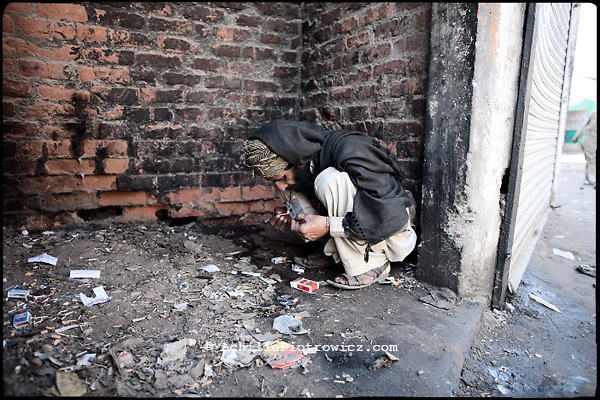 A pathan man smokes heroin hid from the local people ...