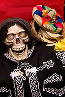 Laughing skull on Mexican Day of the Dead or Dia de los Muertos altar.