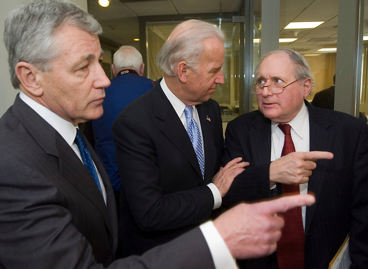 "01/17/07--Sen. Chuck Hagel, R-Neb., Senate Foreign Relations Chairman Joseph R. Biden Jr., D-Del., and Senate Armed Services Chairman Carl Levin, D-Mich., before a news conference introducing their bipartisan resolution expressing opposition to ""deepening our military commitment in Iraq."" The non-binding resolution declares that itÕs Ònot in the national interest of the United States to deepen its military involvement in Iraq.Ó A vote is possible in Biden's committee Jan. 24, a day after President BushÕs State of the Union address. Congressional Quarterly Photo by Scott J. Ferrell"