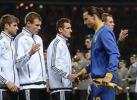 Fussball International  WM Qualifikation 2014   16.10.2012 Deutschland - Schweden Thomas Mueller, Holger Badstuber, Miroslav Klose  (v.li., Deutschland)  mit Zlatan Ibrahimovic (Schweden)