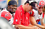 25 September 2005: Michael Vick (left), Quarterback for the Atlanta Falcons, is all smiles as he studies game photos on the sidelines with Offensive Coordinator Gregg Knapp (center) and backup QB Matt Schaub (right) during a game against the Buffalo Bills. The Falcons defeated the Bills 24-16 at Ralph Wilson Stadium in Orchard Park, NY.<br /><br />Mandatory Photo Credit: Ed Wolfstein.