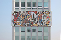 Haus des Lehrers or House of the Teachers, built 1962-64 in East Germany or the GDR, with a mosaic mural by Walter Womacka entitled Unser Leben or Our Life, depicting various occupations in East Berlin, Berlin, Germany. Picture by Manuel Cohen