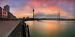 "Dusseldorf, Germany. A view of the Rhine river at sunset, with the TV tower and the motorway bridge in the background. Taken at sunseton a evening of February this is a stitch of 8 vertical frames, each one exposed for 50""."