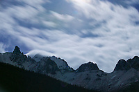 Moonlit clouds over mount Snowden, Brooks range, Alaska