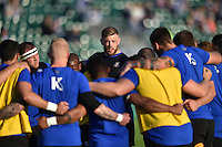 Dave Attwood of Bath Rugby speaks to his team during the pre-match warm-up. West Country Challenge Cup match, between Bath Rugby and Gloucester Rugby on September 26, 2015 at the Recreation Ground in Bath, England. Photo by: Patrick Khachfe / Onside Images