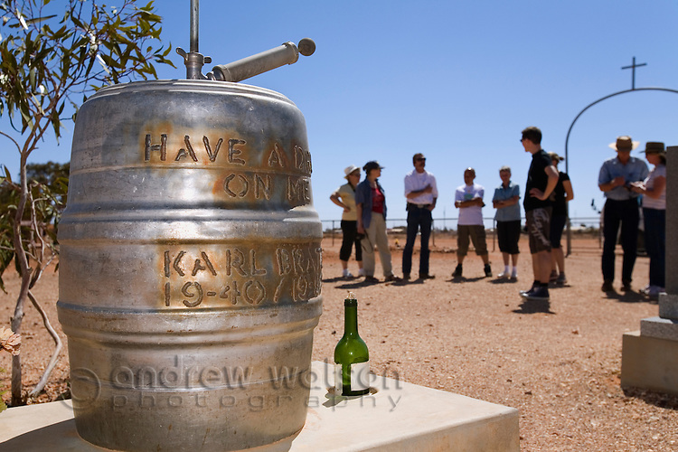 A beer keg headstone is a quirky attraction for cemetery tours in Coober Pedy, South Australia, AUSTRALIA.