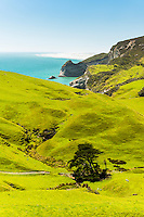 Coastal farmland near Wharariki Beach at Cape Farewell with Farewell Spit just visible in background near Collingwood, Nelson Region, South Island, New Zealand