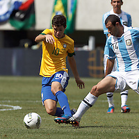 Brazil midfielder Oscar (10) dribbles as Argentina midfielder Javier Mascherano (14) defends. In an international friendly (Clash of Titans), Argentina defeated Brazil, 4-3, at MetLife Stadium on June 9, 2012.