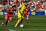 Pat Noonan, Columbus Crew takes the ball from Wilman Conde, Chicago Fire