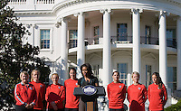 Cheryl Bailey, Becky Sauerbrunn, Rachel Buehler, Nicole Barnhart,  Michelle Obama, Alex Morgan, Lori Lindsey, Kelley O'Hara. Michelle Obama hosted a Lets Move! soccer clinic held on the South Lawn of the White House assisted by members of the USWNT.  Let's Move! was started by Mrs. Obama as a way to promote a healthier lifestyle in children across the country.