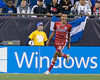 Foxborough, Massachusetts - May 21, 2016: In a Major League Soccer (MLS) match, FC Dallas (red) defeated New England Revolution (blue/white), 4-2 (halftime), at Gillette Stadium.<br /> Goal celebration.