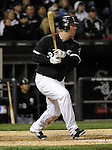 CHICAGO - APRIL 12:  Adam Dunn #32 of the Chicago White Sox singles against the Oakland Athletics on April 12, 2011 at U.S. Cellular Field in Chicago, Illinois.  The White Sox defeated the Athletics 6-5.  (Photo by Ron Vesely)  Subject:  Adam Dunn