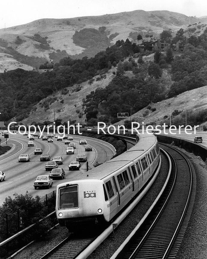 Bay Area Rapid Transit( BART) train  runs thru Contra Costa County, near Orinda, California.<br />(photo 1985 by Ron Riesterer)