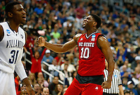 PITTSBURGH, PA - MARCH 21: Lennard Freeman #10 of the North Carolina State Wolfpack celebrates after making a shot in front of Dylan Ennis #31 of the Villanova Wildcats in the second half during the third round of the 2015 NCAA Men's Basketball Tournament at Consol Energy Center on March 21, 2015 in Pittsburgh, Pennsylvania.  (Photo by Jared Wickerham/Getty Images)