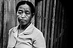 "Mekong Dam Victims - Cambodia. After losing livestock and ricefields in floodings, Mrs. K. decided to sell her last waterbuffalos and move with her family further away from the river. As one of the spokeswomen in the village her new house has now become a meeting point to discuss the problems caused by the dam for the representatives from the affected villages in the area. At least 55.000 people living near the Sesan river in Cambodia's Ratanakiri and Stung Treng provinces continue to suffer due to lost rice production, lost fishing income, drowned livestock and damaged vegetable gardens, and so also great economical losses, because of the unpredictable floodings from the Yali Falls Dam on the other side of the border in Vietnam. To this day, flash floodings have caused the deaths of at least 39 villagers from various ethnic minority groups living along the river. Despite this, four other major hydropower projects are now in operation or under construction on the Sesan River in Vietnam. Known as ""The Mother of Waters"", more than 60 million people depend on the Mekong river and its tributaries for food, fresh water, transport and other aspects of daily life. The construction of big dams is now threatening the life of these people aswell as the vital and unique ecosystem of the river."