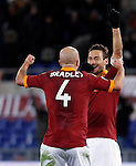 Calcio, Serie A: Roma vs Fiorentina. Roma, stadio Olimpico, 8 dicembre 2012..AS Roma forward Francesco Totti celebrates with teammate Michael Bradley, left, after scoring his second goal during the Italian Serie A football match between AS Roma and Fiorentina at Rome's Olympic stadium, 8 december 2012..UPDATE IMAGES PRESS/Isabella Bonotto