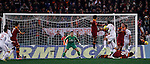 Calcio, Serie A: Roma vs Milan. Roma, stadio Olimpico, 22 dicembre 2012..AS Roma defender Nicolas Burdisso, of Argentina, fourth from right, heads to score during the Italian Serie A football match between AS Roma and AC Milan at Rome's Olympic stadium, 22 December 2012..UPDATE IMAGES PRESS/Isabella Bonotto