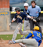 TORRINGTON, CT-042017JS09- Wolcott Tech's Mitchell Sorenson (5) comes in to score on a passed ball as Harding's Howard Stultz  (11) covers the play during their game Wednesday at Fuessenich Park in Torrington. <br /> Jim Shannon Republican-American