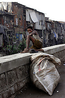 A rag picker takes a rest on 21st Oct 2006. Rag Pickers walk the streets looking for material that can be recycled. Dharavi is Bombays main recycling area area.