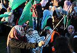 Palestinian women take part during a rally in Gaza City December 6, 2015 in support of Palestinian stabbing attacks against Israelis. Israeli forces on Sunday detained a Palestinian schoolgirl who was allegedly carrying a knife near the Wadi Helwa area of occupied East Jerusalem Silwan neighborhood. Photo by Mohammed Asad
