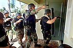 Collier COunty SWAT team members practice entering into a house during an exercise in Naples Florida. Erik Kellar