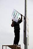 ERBIL, IRAQ:  An election worker hangs a party sign for an islamic party on the first day of official election campaigning...Election workers start their campaigns for the Iraqi Parliamentary Elections due to be held March 7th, 2010...Photo by Refik Tekin/Metrography