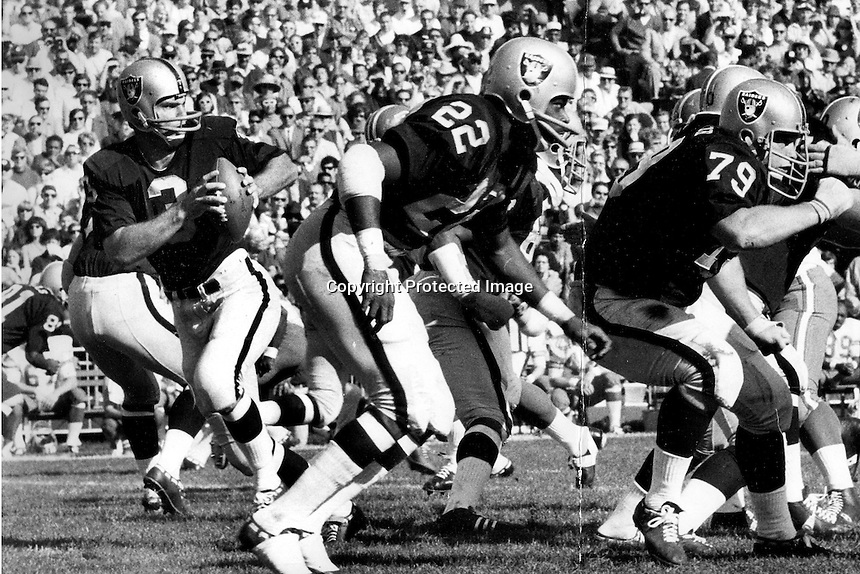Oakland Raider quarterback Daryle Lamonica fades back to pass. (1969 photo by Ron Riesterer)