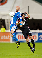 Daniel Woolard (21) of D.C. United goes up for a header with Conor Casey (6) of the Philadelphia Union during a Major League Soccer game at RFK Stadium in Washington, DC. D.C. United tied the Philadelphia Union, 1-1.