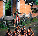 Colourfully dressed participants in the historical monkey dance taking place in the historical religous shrines and temples of Bali, Indonesia