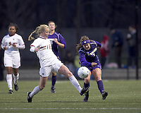 "University of Washington midfielder Kellye Joswick (7) shoots the ball as Boston College midfielder Julia Bouchelle (12) defends. In overtime, Boston College defeated University of Washington, 1-0, in NCAA tournament ""Elite 8"" match at Newton Soccer Field, Newton, MA, on November 27, 2010."