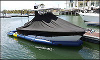 BNPS.co.uk (01202 558833)<br /> Pic: FabDock/BNPS<br /> <br /> That's clever - Personal dry dock invention solves boat owners age old problem of keeping their hulls clean.<br /> <br /> This groundbreaking inflatable dock lets boat owners keep their vessel dry and foul-free while simultaneously floating in the water. <br /> <br /> The 'Fab Dock' provides a protective capsule for boats to dock inside, protecting them from the ravages of salt water, which causes devastating corrosion. <br /> <br /> Designers say the product will help owners save money on maintenance costs as well as preserving the value of their boat. <br /> <br /> The product comes in three sizes for boats between 15ft and 29ft and costs from &pound;6,495 to &pound;9,495.