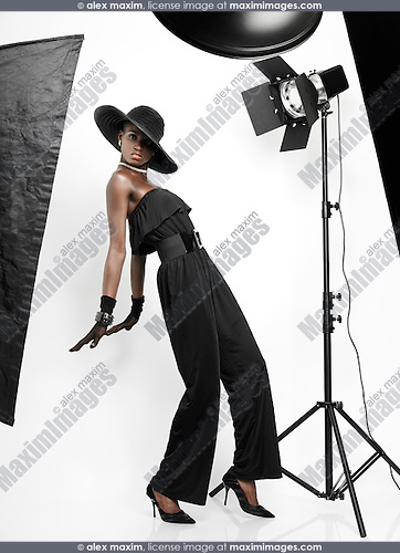 Stock photo: Elegant young feamale fashion model in studio settings ...