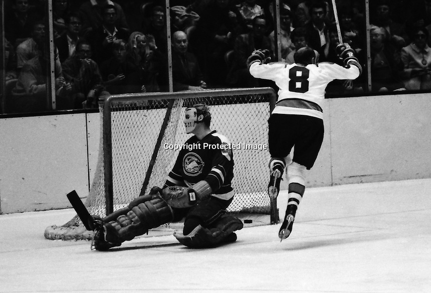 Seals vs Pittsburg Penguins...#8 Val Fonteyne scores against Seal goalie Cris Worthy(1970 photo by Ron Riesterer)