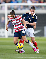 Carli Lloyd (10) of the USWNT fights for the ball with Leanne Crichton (14) of Scotland during the game at EverBank Field in Jacksonville, Florida.  The USWNT defeated Scotland, 4-1.