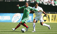 Giovani Dos Santos (17) dribbles the ball against David Solorzano (20). Mexico defeated Nicaragua 2-0 during the First Round of the 2009 CONCACAF Gold Cup at the Oakland, Coliseum in Oakland, California on July 5, 2009.
