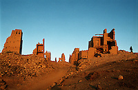 The town of Old Marib, Yemen's oldest city, where caravans would stop on their way from Wadi Hadramawt to Sana'a. Nearly three thousand years ago it became the capital of the Sabaean empire, the most celebrated of southern Arabia's ancient civilisations, and is claimed as the home of the legendary Queen of Sheba. The town fell into disuse after being bombed during the civil war of the 1960s. The surrounding area is now the centre of Yemen's oil industry, which makes it a particularly sensitive area in security terms.