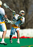 19 March 2011: University of Vermont Catamount Attacker Geoff Worley, a Junior from Coronado, CA scores one of his 3 goals against the St. John's University Red Storm at Moulton Winder Field in Burlington, Vermont. The Catamounts defeated the visiting Red Storm 14-9. Mandatory Credit: Ed Wolfstein Photo
