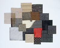 A collection of fabric swatches illustrating the colour range from driftwood to elephant