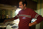 December 16, 2010. Raleigh, NC.. TP Mishra makes traditional Bhutanese tea in his apartment.. TP Mishra, a refugee from Bhutan, has recently relocated from the Bronx to Raleigh, where he lives in an suburban apartment  with his wife, as well as another Bhutanese couple.