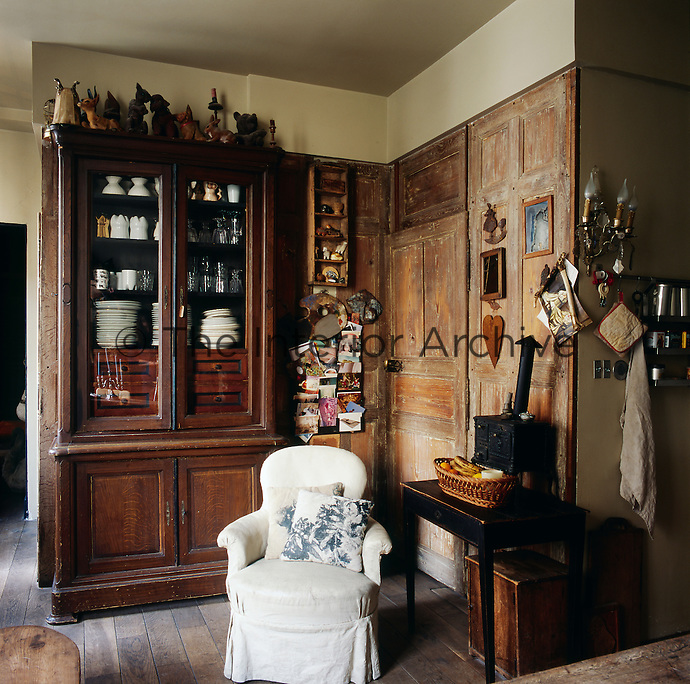 The living dining area has an old fashioned feel with simple wooden furniture and bare floorboards