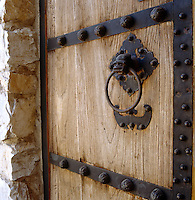 The front door is of thick wood held together by iron bands and with a bat holding the ring handle to symbolise 'good luck'