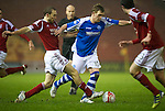 Aberdeen v St Johnstone..22.12.12      SPL.Liam Craig is tackled by Russell Anderson.Picture by Graeme Hart..Copyright Perthshire Picture Agency.Tel: 01738 623350  Mobile: 07990 594431