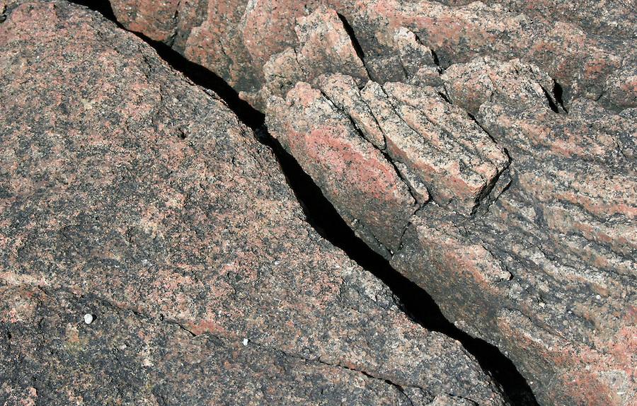 Seaside background of raw granite