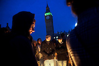 Protestors light a fire to keep warm on Parliament Square outside the Houses of Parliament during a student demonstration in Westminster, central London on the day the government passed a bill to increase university tuition fees. .