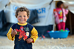 A child in the Zaatari Refugee Camp, located near Mafraq, Jordan. Opened in July, 2012, the camp holds upwards of 50,000 refugees from the civil war inside Syria, but its numbers are growing. International Orthodox Christian Charities and other members of the ACT Alliance are active in the camp providing essential items and services.