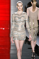 Katia walks runway in a creme caramel three quarters sleeve beaded sheath dress, from the Reem Acra Fall 2012 Feminine Power collection fashion show, during Mercedes-Benz Fashion Week New York Fall 2012 at Lincoln Center.