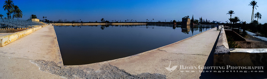 Morocco, Marrakesh. Panorama of the artificial lake at The Menara gardens located to the west of Marrakesh.